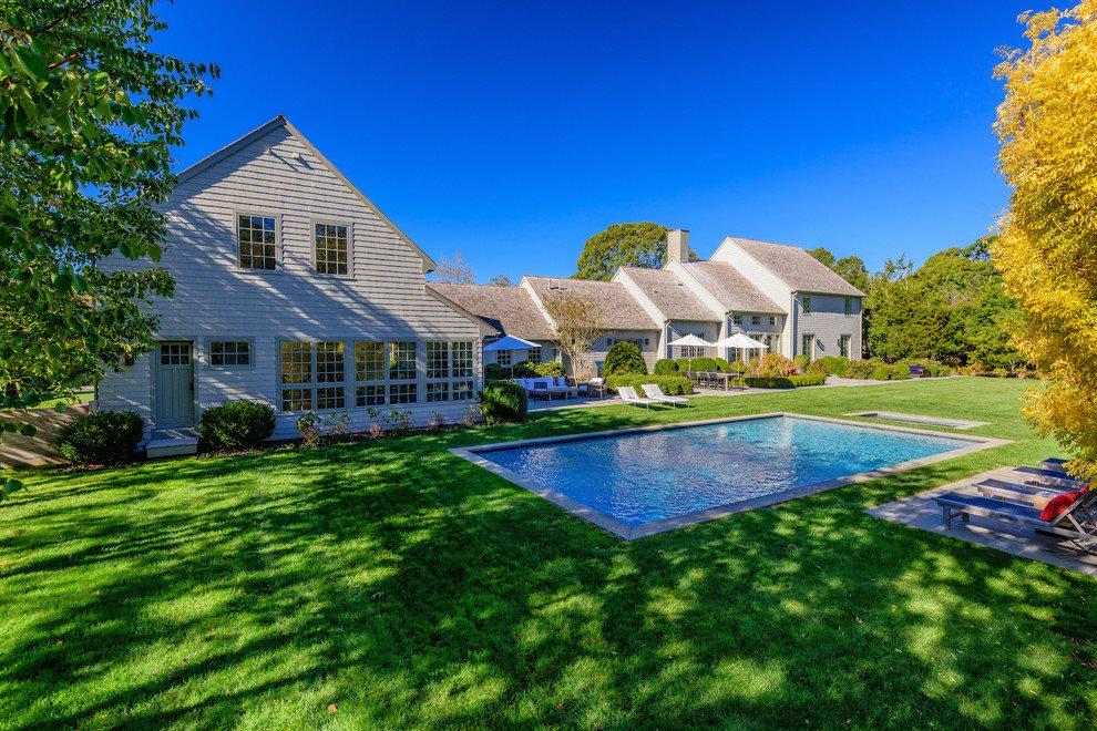 Back yard with heated gunite pool and spa