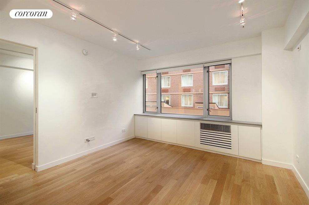 Spacious Living Room with hardwood floors