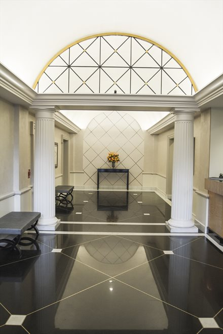 Lobby with arched ceiling and marble floors