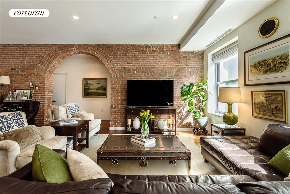 Living Room with Exposed Brick Arch