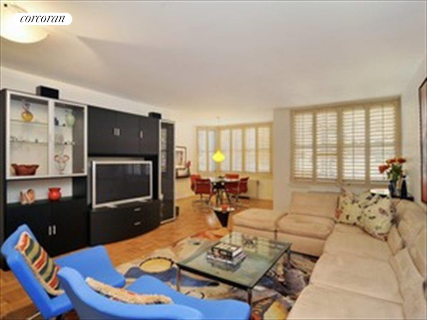 Spacious living room with bay windows