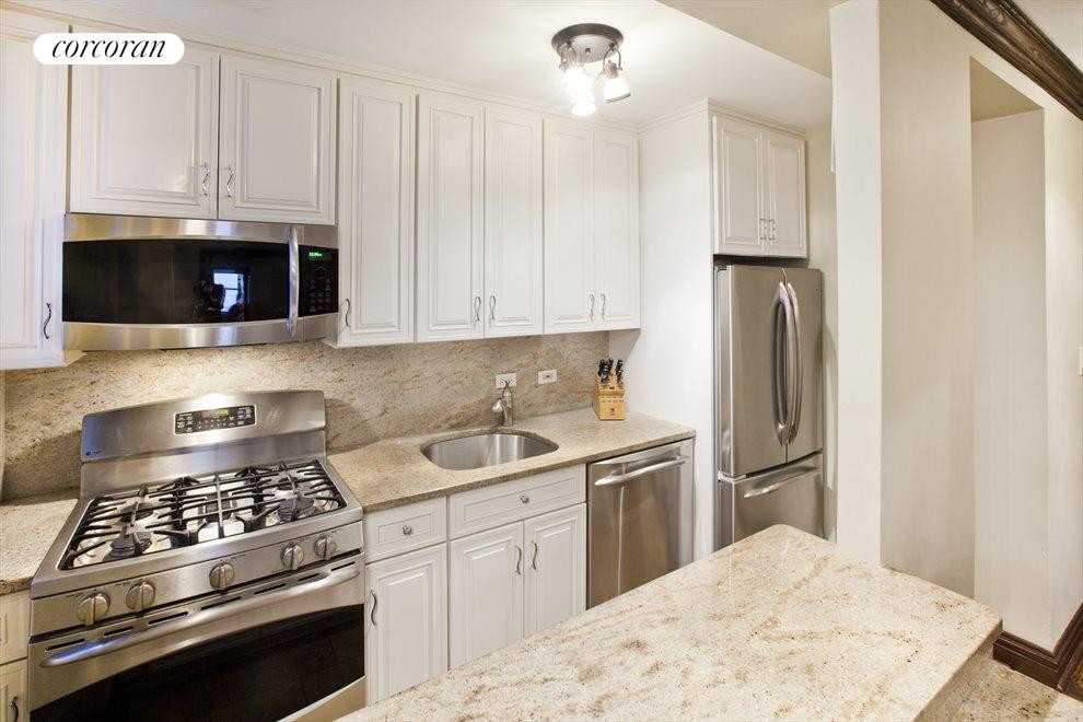 Renovated Kitchen with Stainless Steel Appliances.