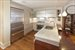 163 West 18th Street, 3A, Chef's kitchen and cherry wood breakfast bar