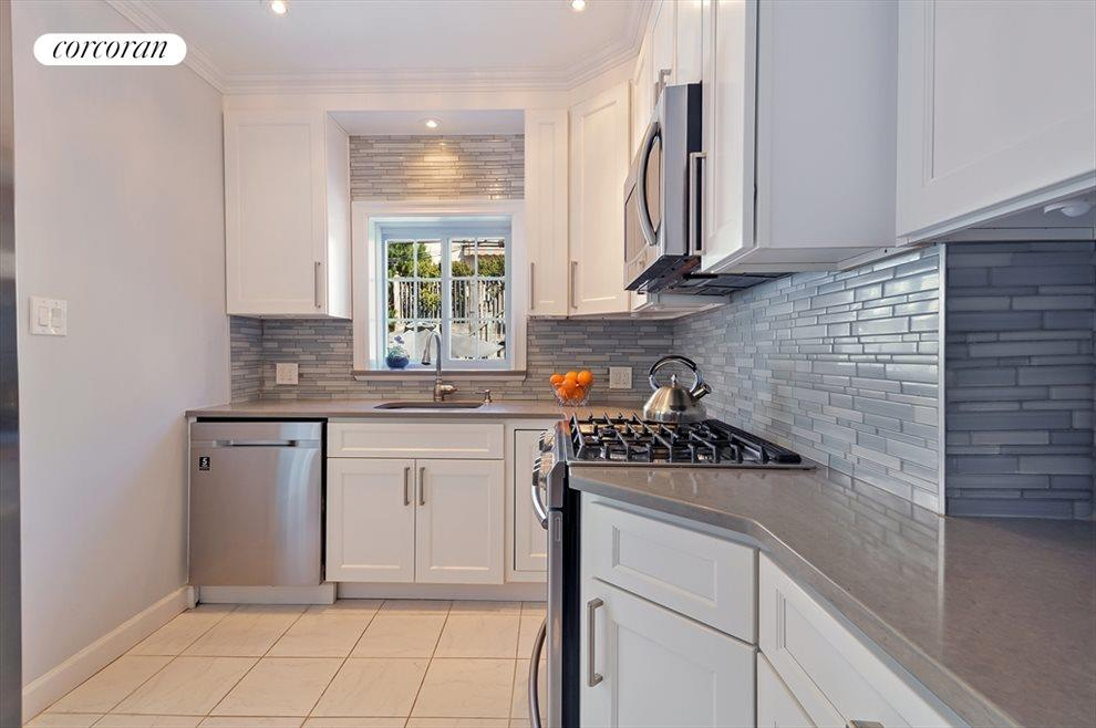 Renovated Kitchen Leading to Rear Yard