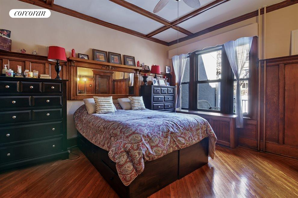 Bedroom with Coffered Ceiling & Wainscoting