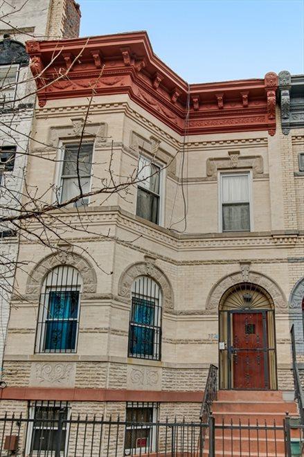 Handsome Romanesque Revival brick facade