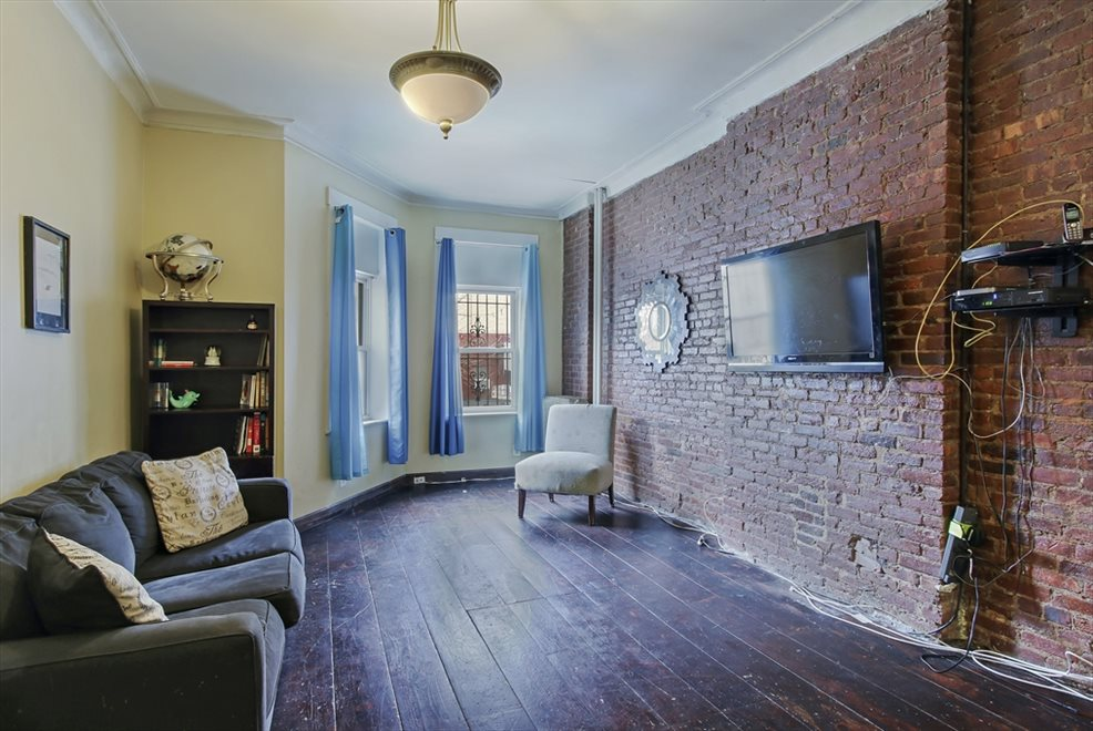 Exposed brick wall and high ceilings
