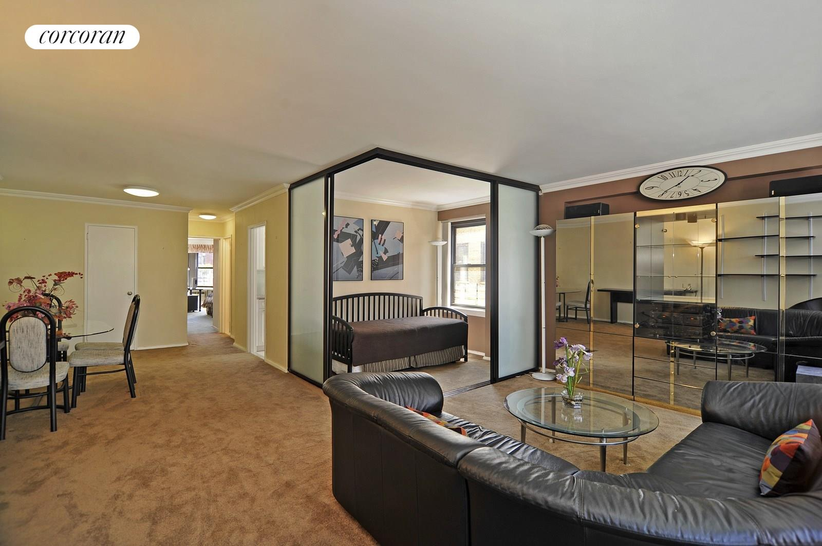 399 East 72nd Street, 7B, Spacious Living Room with a Wall of Windows