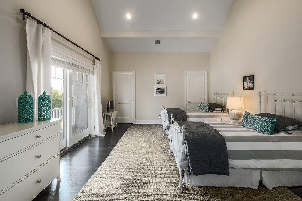 Guest bedroom with deck overlooking grounds