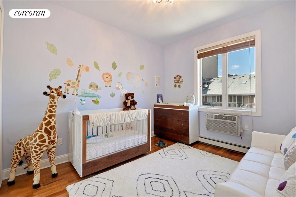 Second bedroom, bright with oversize windows.