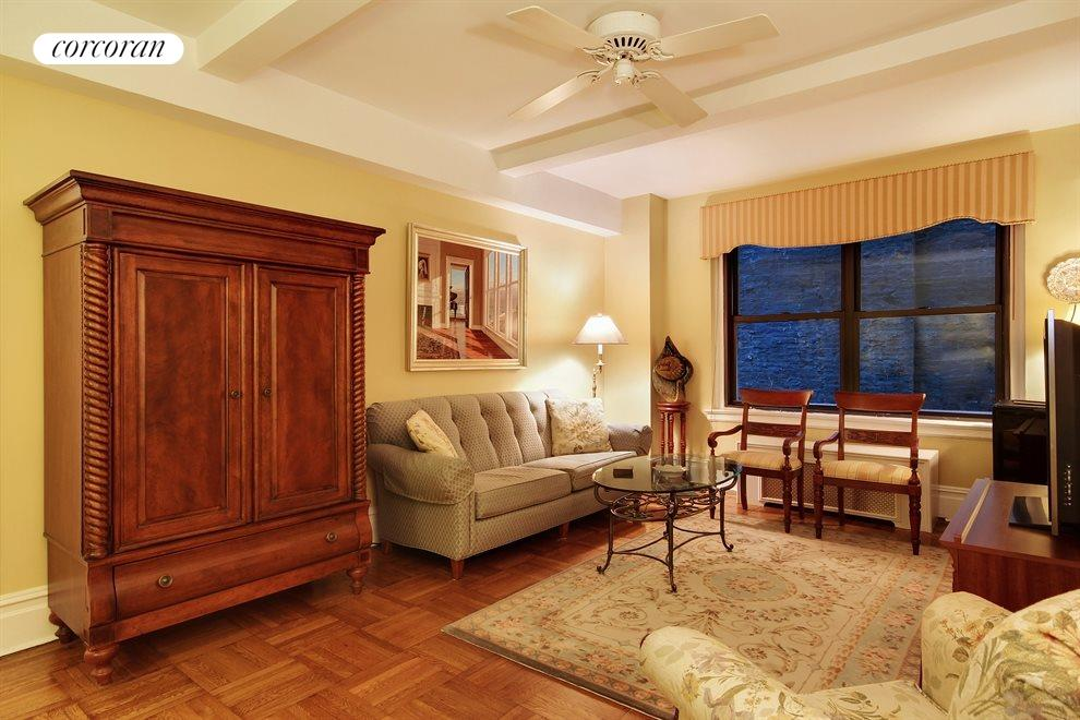 Living room with beamed ceilings, arch