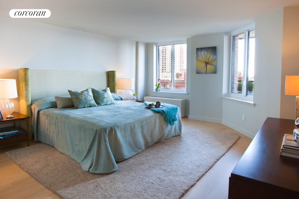 Spacious master bedroom measuring 15 x 13 with views of Rector Park, the Hudson River, and Ellis Island.