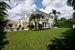 Enjoy the outdoors and fabulous amenities of this 13,479 SF home on an oversized Palm Beach property