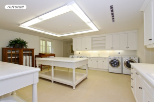 Oversized laundry room ont he lower level has a staff kitchenette