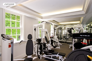 Fully equipped gym with outdoor shower overlooks the cabana and pool area
