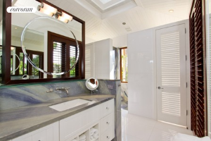 Master bath flooded with natural light