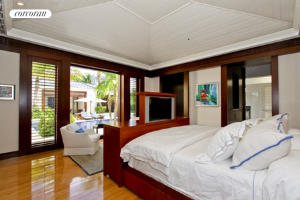 Master bedroom with a view to the pool