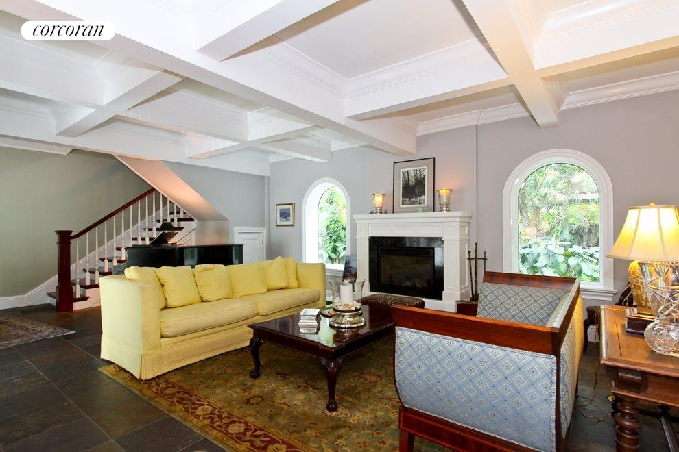 Couffered ceilings, arched windows & fireplace