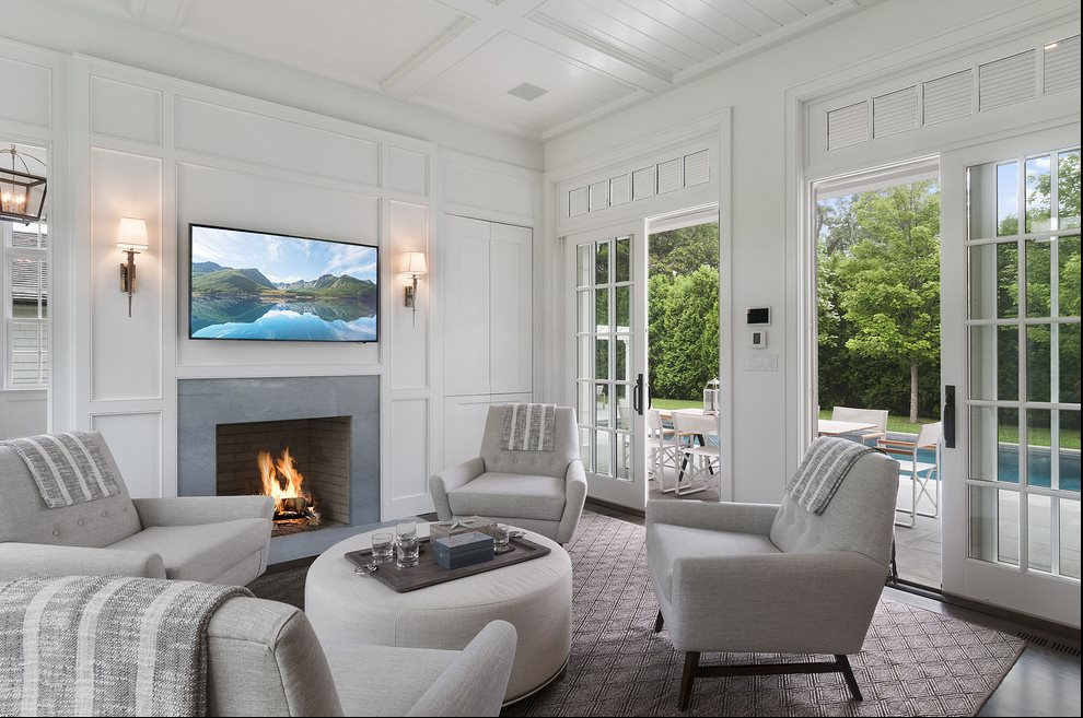The Hamptons Real Estate | View 60 Herrick Road | Great Room With Fireplace And Access To Terrace, Pool and Yard