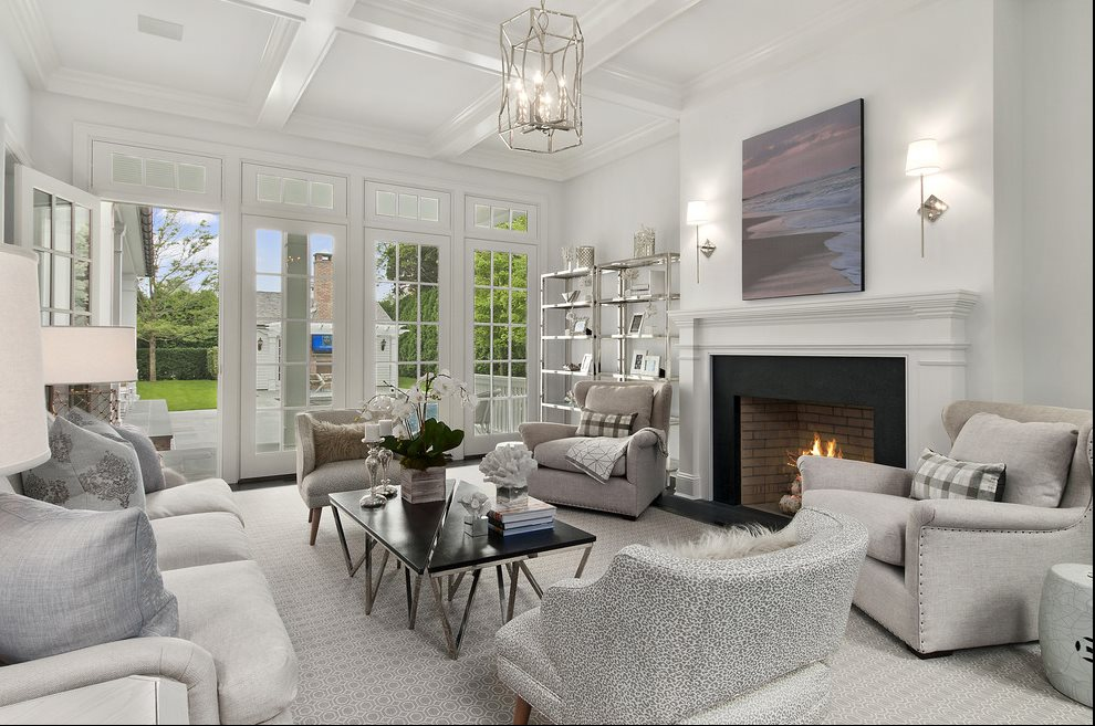 The Hamptons Real Estate | View 60 Herrick Road | Living Room With Fireplace And Access To Terrace