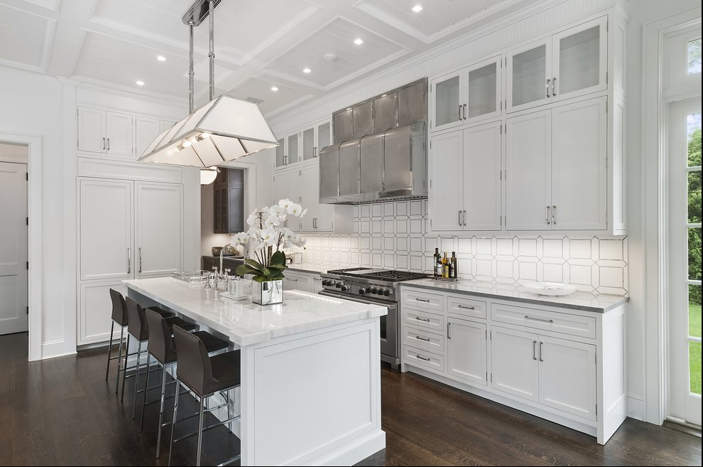 The Hamptons Real Estate | View 60 Herrick Road | Sunlit Kitchen With Views Of Terrace And Pool Area