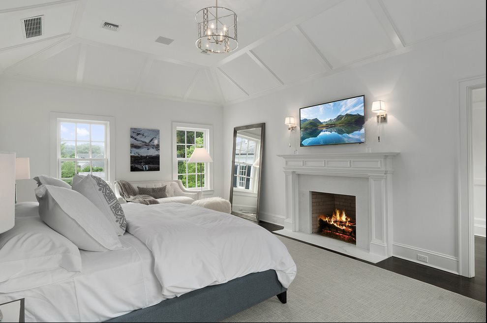 The Hamptons Real Estate | View 60 Herrick Road | Master Bedroom With Fireplace
