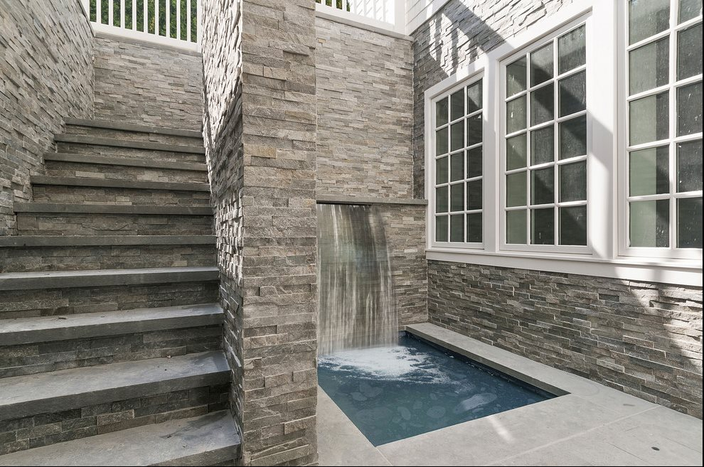 The Hamptons Real Estate | View 60 Herrick Road | Lower Level Spa With Waterfall