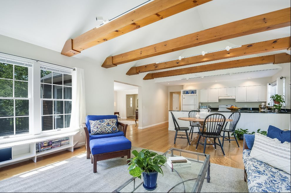 Open floor plan with beamed cathedral ceiling