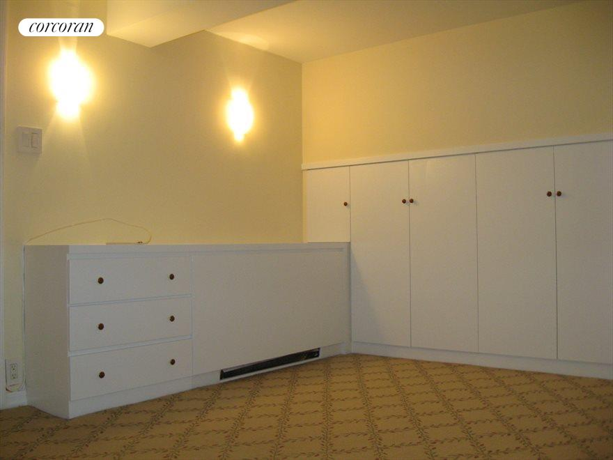 Master bedroomw with walk-in closet