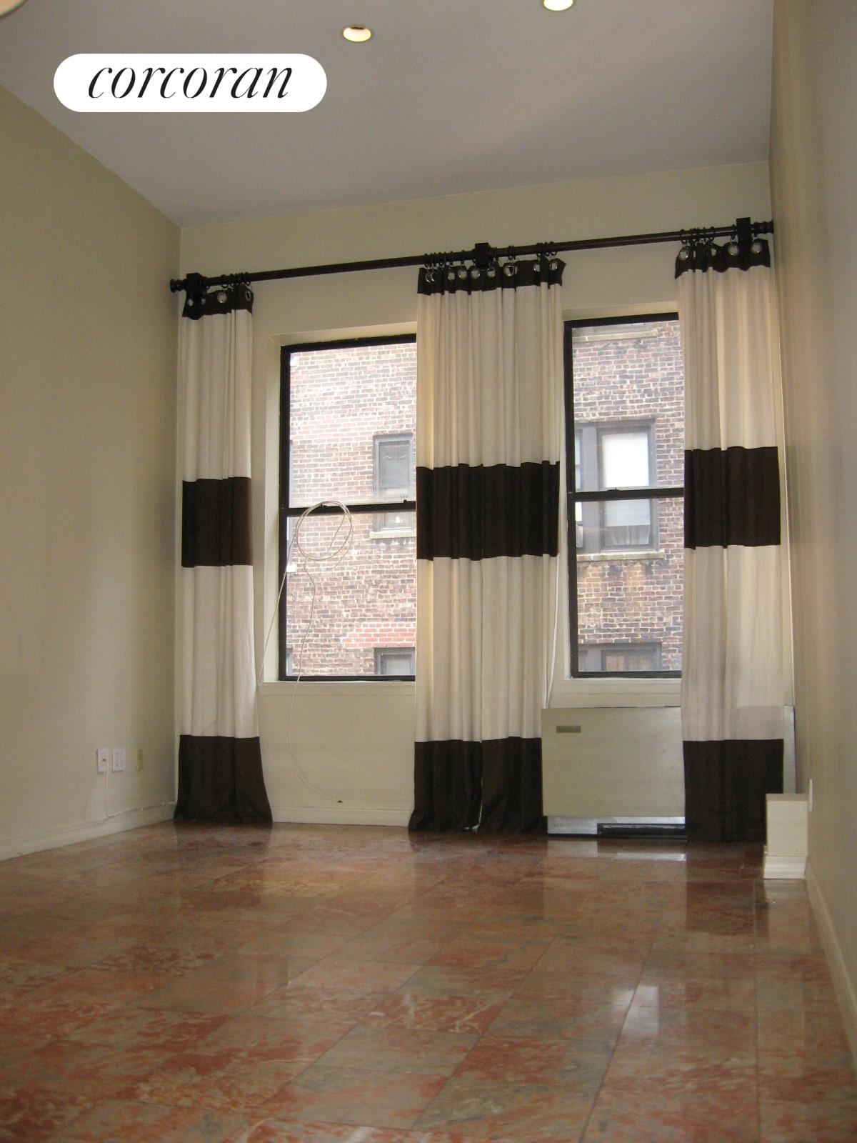 253 West 73rd Street, 6H, Living room with double height ceilings