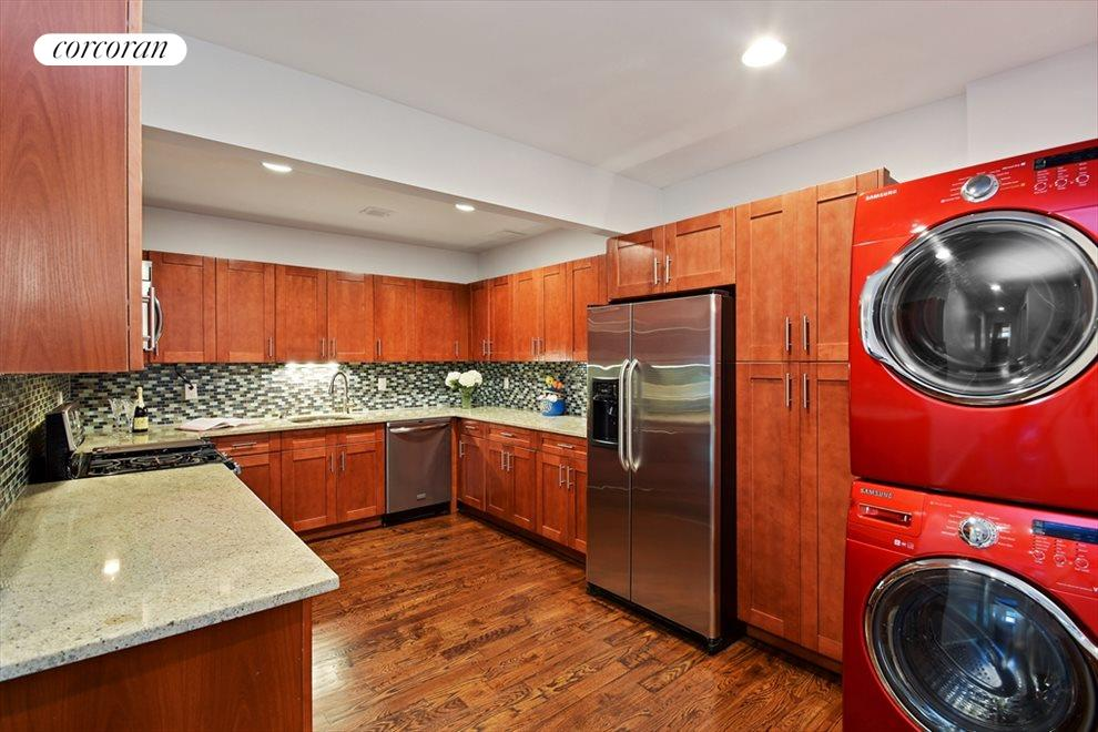 Kitchen with washer dryer convenience.