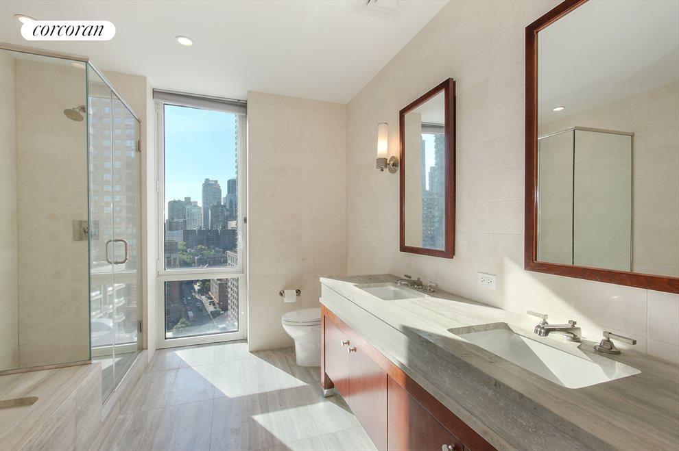 Beautiful Windowed Bathroom with Dual Sinks