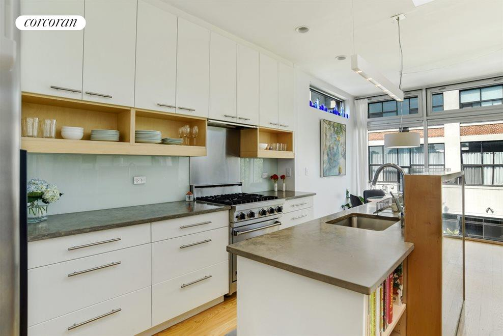 Open plan chef's kitchen w/dining and living room