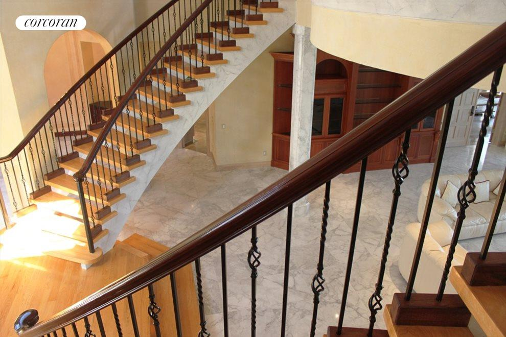 Dramatic double staircase entrance
