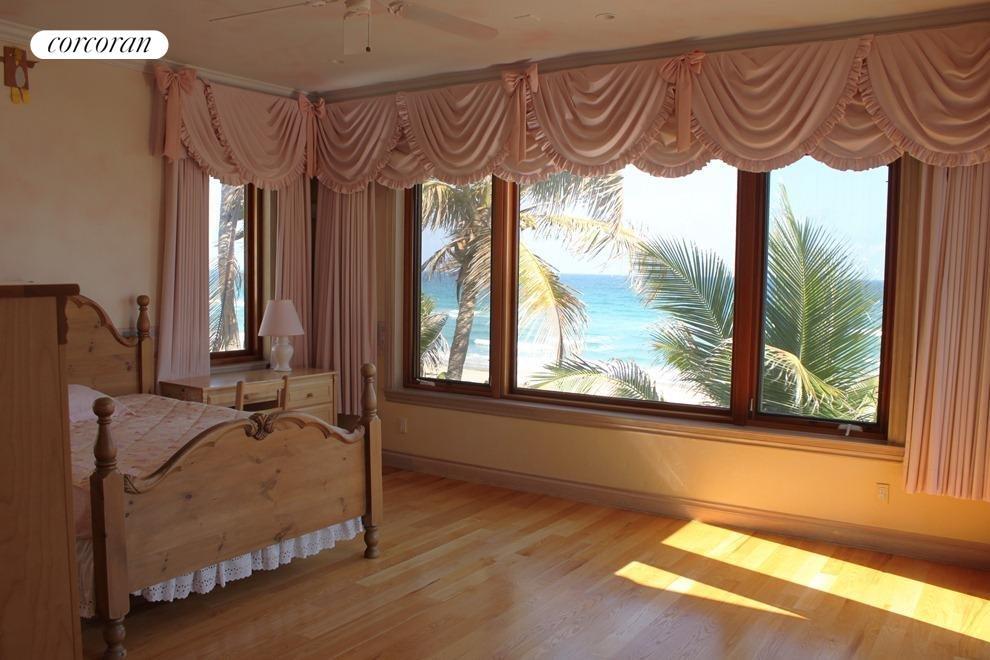 Large windows open onto ocean views
