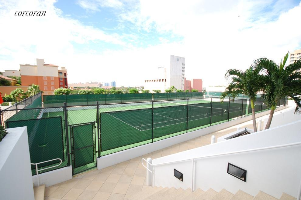 Downtown living with tennis courts