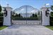 1220 South Ocean Blvd, French lamp posts illuminate gated entrance