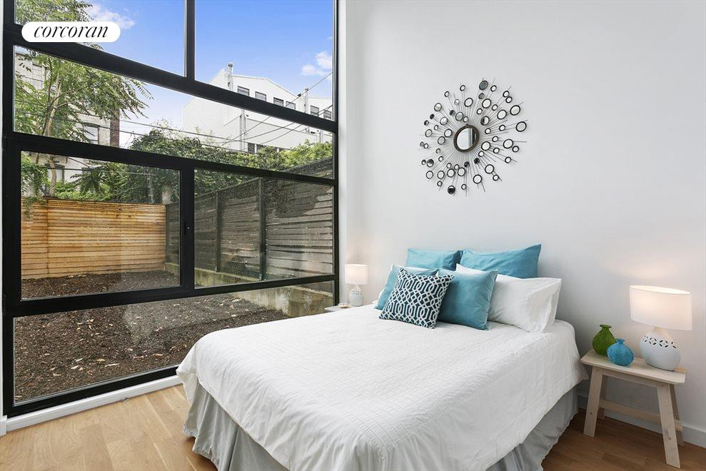 Bedroom Looks Out Into Private Garden