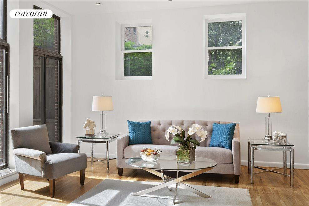 Sunny loft living room with multiple exposures