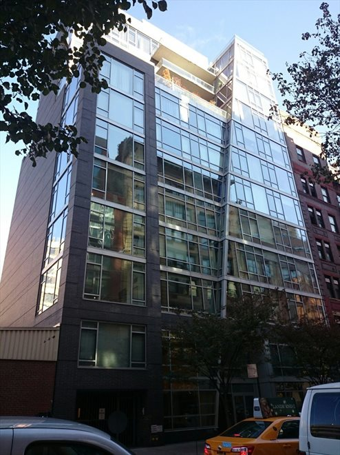 Glass facade on tree-lined 18th Street