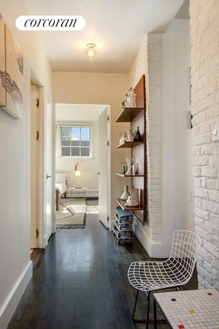 Bedroom wing hall with exposed brick
