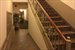 105 West 77th Street, 3E, Package delivery area behind staircase.