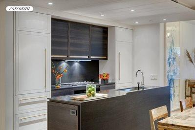 Artisan crafted kitchen with bronze detail