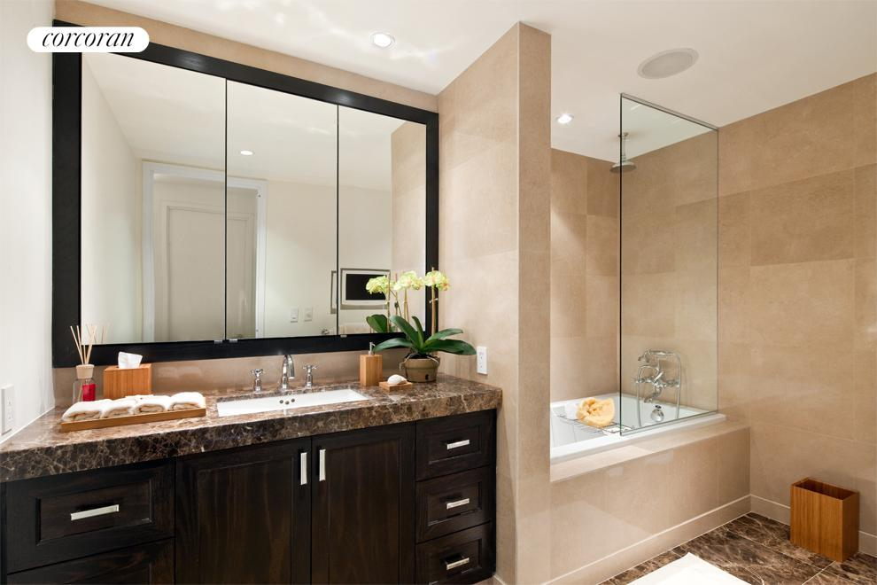 Master bathroom featuring imported Italian marble, separate shower from bath tub, and integrated flat screen TV.