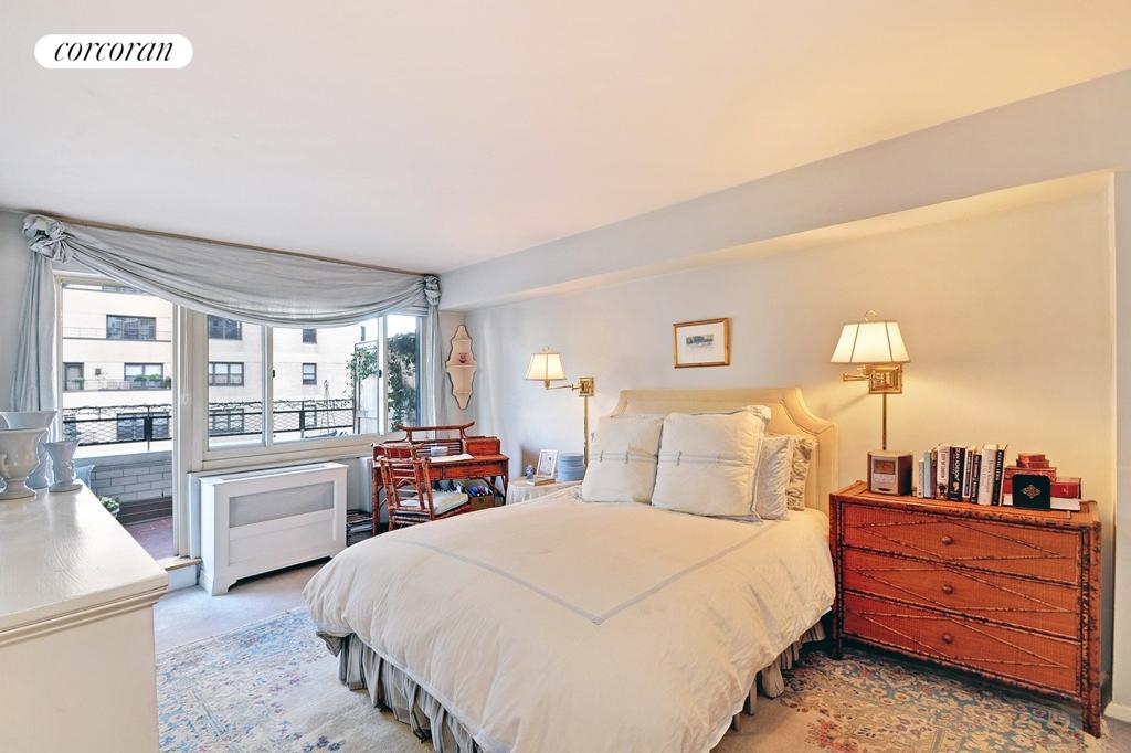 The master bedroom boasts a large private terrace