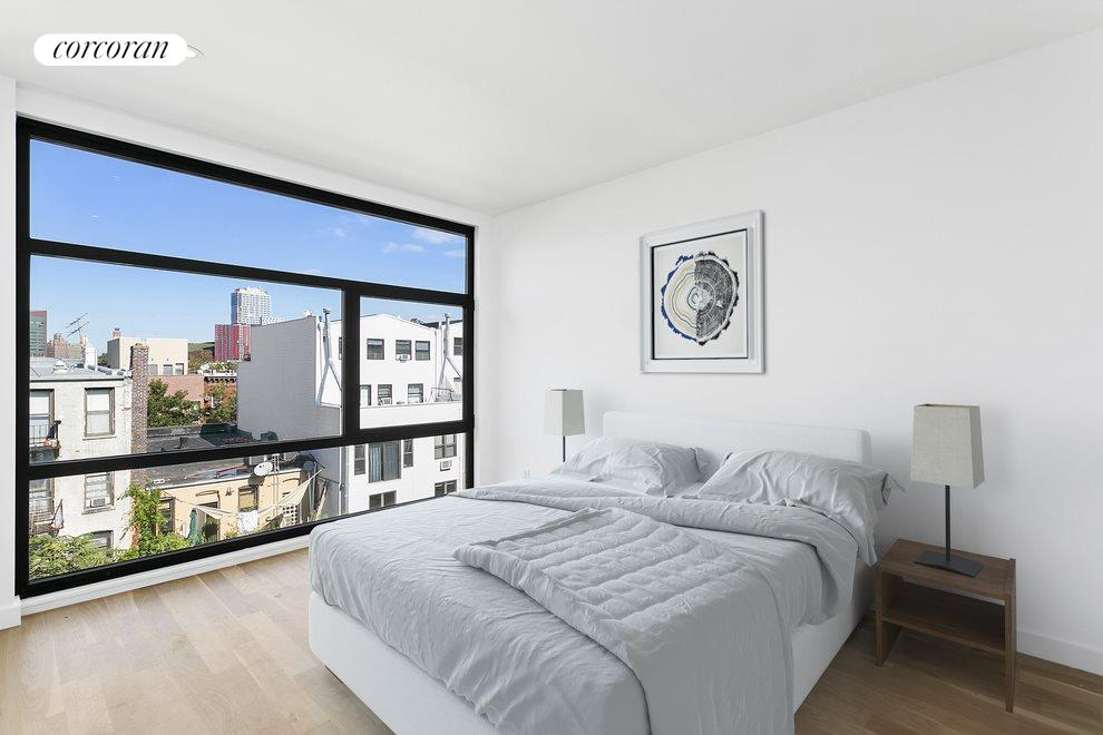 Bright Bedroom with Floor to Ceiling Windows