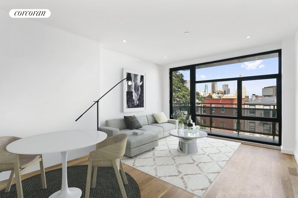 Living Room with Balcony Overlooking Courtyard