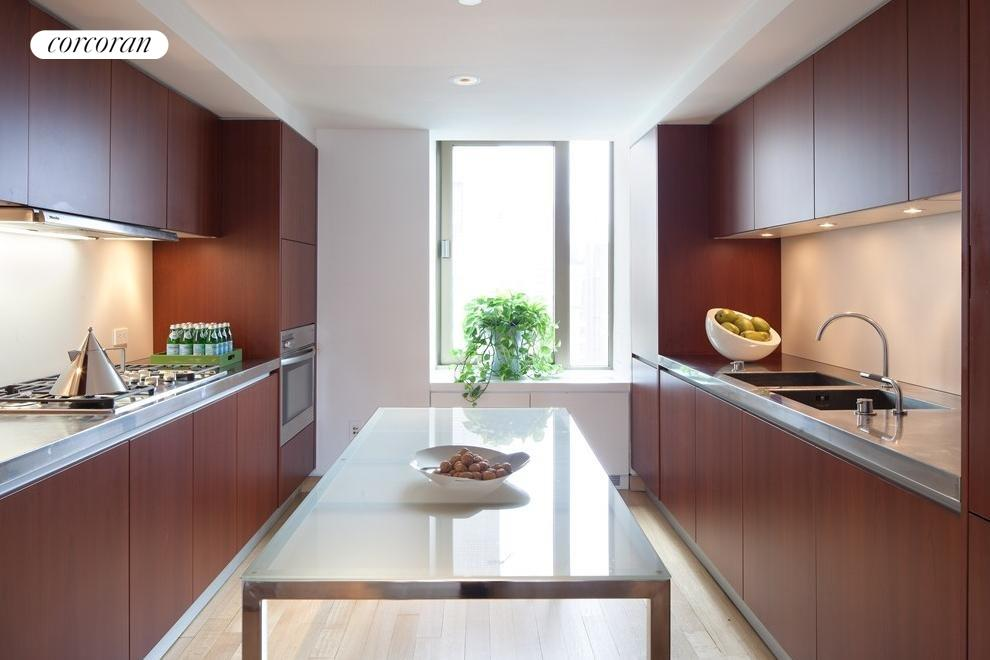 Stainless steel countertops & redwood cabinets.