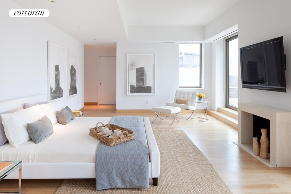 Enormous master suite w/ direct access to terrace.