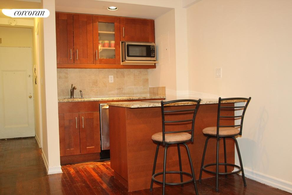 Renovated kitchen with bar
